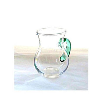Hand blown small glass creamer with green handle