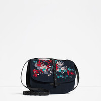 EMBROIDERED LEATHER MESSENGER BAG