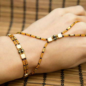 The Cleopatra Handflower.  Gold, dark chocolate and burnt orange beaded all in one slave bracelet with extender. Hand Chain By Molax Chopa