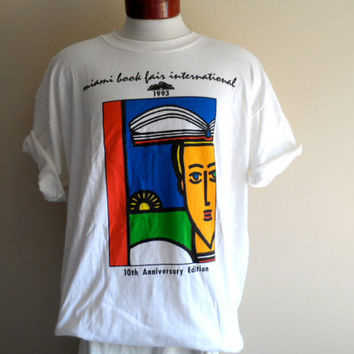 vintage 90s Miami Book Fair International 1993 white graphic t-shirt bright primary color print red blue green yellow crew neck tee oversize