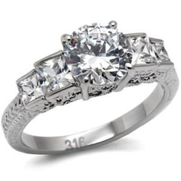 Lovable - Quality Craftsmanship Adorable Engagement Ring with Round Cut Cubic Zirconia Additional CZs with Princess Cut Stones