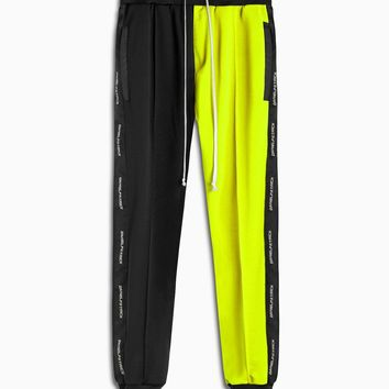 50/50 track pant / black + neon yellow