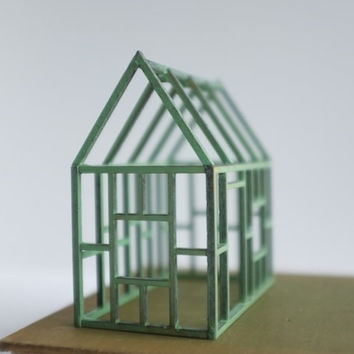 Small verdigris geometric framework house in birch