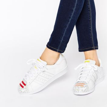 adidas Originals Pharrell Printed Shell Suede Superstar Trainers at asos.com