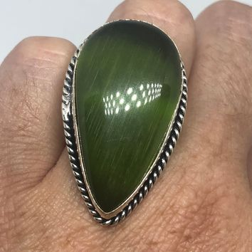 Vintage Jade Green Cat's Eye Art Glass ring about an inch long knuckle ring
