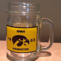 Vintage collectible souvenir handled mason jar type glass for 1983 Iowa Hawkeyes. Appears it originally held a soup mix from Mary and Ken's,