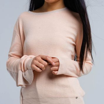 Pink sweater with shiny ruffle