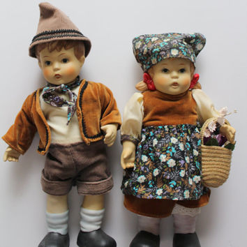 Vintage Set of Hand Painted Bisque Porcelain Alpine Boy and Girl Dolls 1982