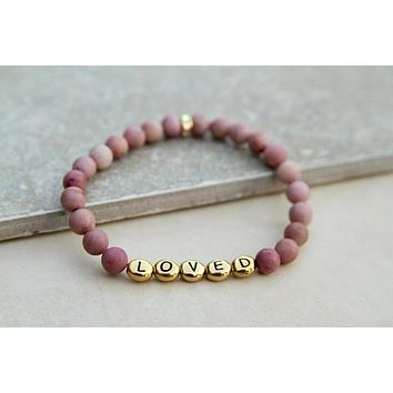 Loved Gemstone Stretch Bracelet in Rhodonite with Gold Letters