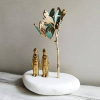 Two men sculpture. brass men figurines under tree, mastic tree sculpture with brass figures, metal sculpture of tree and men on stone