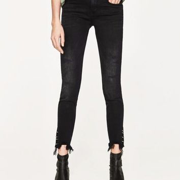 Mid Rise Skinny with Metal Grommets