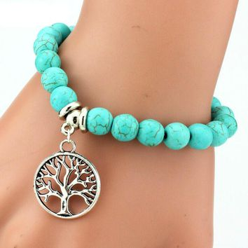 Natural Turquoise Color Onyx Bead Bracelet with Multiple Charms