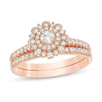 1/2 CT. T.W. Diamond Flower Frame Bridal Engagement Ring Set in 14K Rose Gold