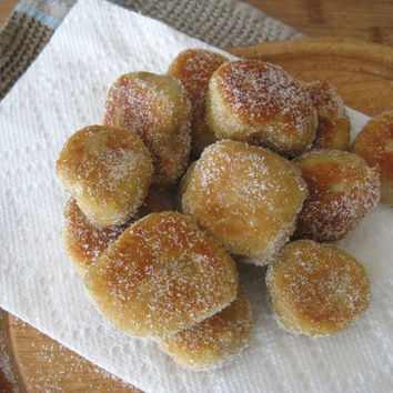 Homemade Portuguese Doughboys, Malassadas with sugar and cinnamon cover, small round munchkins or round balls