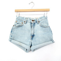 "90's High Rise Distressed Levi's cut offs size - XS/S -  27"" Waist"