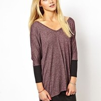 ASOS Oversized Top with Deep V and Ribbed Sleeve at asos.com