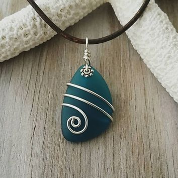 Handmade in Hawaii, Wire wrapped  leather cord unisex teal blue sea glass necklace, unisex jewelry, man jewelry, Sea glass jewelry.
