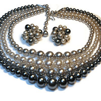 Stunning 4 strand gray graduated pearl neckace and cluster earrings marked Japan in shades of gray