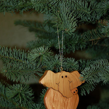 ELEPHANT CHRISTMAS ORNAMENT Carving.  With it's charming and endearing expression, it's hard to resist adding it to your holiday tree.