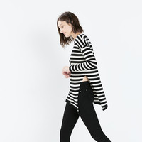 Long fine-knit asymmetrical sweater