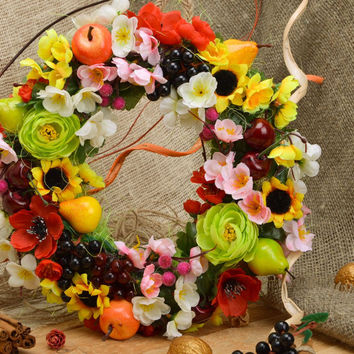 Handmade large bright door wreath with artificial flowers and fruits for home de