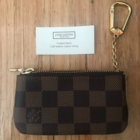 Authentic Louis Vuitton brown leather coin purse/ key holder