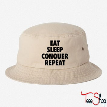 eat conquer sleep repeat bucket hat