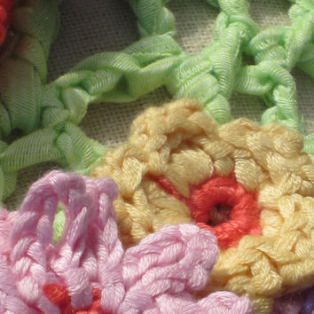 crochetted pillow with bird and flowers