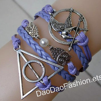 The Hunger Games - Mockingjay inspired unique ancient silver bracelet, Harry Potter, cute owl bracelet, a couple of leather bracelets,