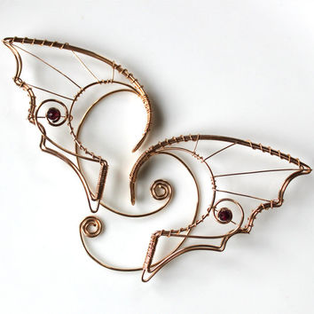 Bronze dragon ears with garnet