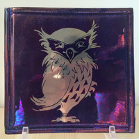 Owl Lustreware tile ,  on a rich copper blue ground .