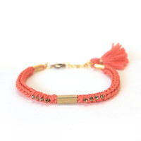 Coral bracelet with tassel charm, orange friendship bracelet with rhinestones, knit bracelet with tube