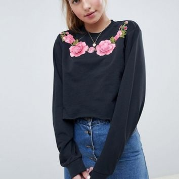 ASOS DESIGN sweatshirt with floral embroidery in washed black at asos.com
