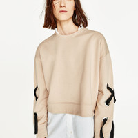 SWEATSHIRT WITH BOW DETAILS