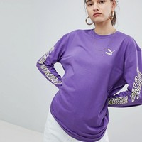 Puma Exclusive To ASOS Long Sleeve T-Shirt With Neon Back Graphic In Purple at asos.com