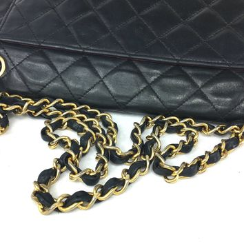 CHANEL Black Quilted Double-Flap Bag