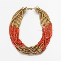 out and about necklace - gold/coral at Esther Boutique