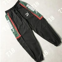 PUMA couple color matching logo letter printing pants summer men and women casual sports beam trousers Black