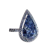 Blue sparkling diamonds pear cut engagement ring