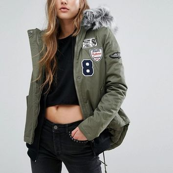 Missguided Badge Faux Fur Collar Parka at asos.com