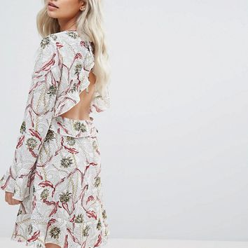 Boohoo Petite Floral Print Open Back Skater Dress at asos.com