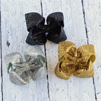 Hair bows for Girls, Toddler and Baby. 4 inch glitter hairbows in black, gold and silver with you chose of alligator clip, snap clip or barrette