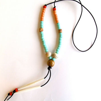 Long beaded necklace with pastel mint and peach Native American crow beads white bone beads on dark brown leather cord Southwest inspired