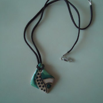 FREE SHIPPING! Handmade ceramic pendant. Clay medallion. Green, black, cream.