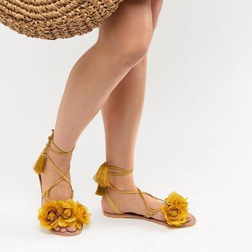 River Island Leather Flower Tassel Tie Up Sandals at asos.com