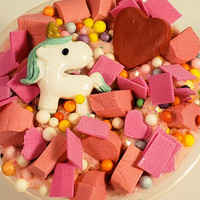 Unicorn Slime called Unicorn Kisses with Glitter tons of Chunks and Scented like Flowers and added Charms