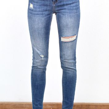 Mid-Rise Ripped + Cut Out Hem Skinny Jeans {Md. Wash}