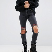 The Ragged Priest High Waisted Mom Jeans With Ripped Knee And Flame Embroidery at asos.com