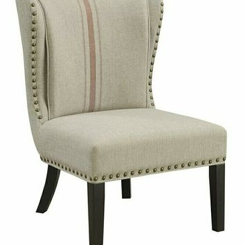 Lizette collection tan/orange fabric upholstered accent chair with nail head trim