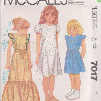 Vintage 1980s pattern for girls short sleeved or sleeveless ruffled dress in above knee or floor lengh size 8 breast 27 McCall's 7017 UNCUT